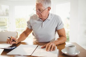 worried senior man with tax documents at home 2021 08 28 16 41 30 utc